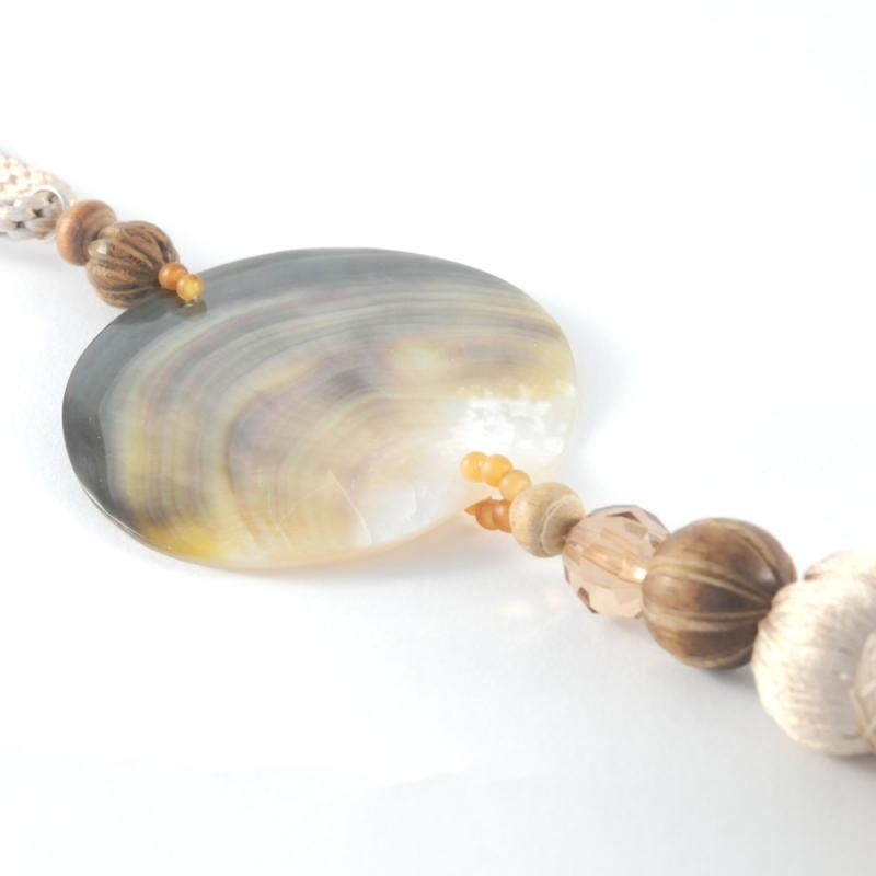 Round Shell Tie Back With Beige Tassel